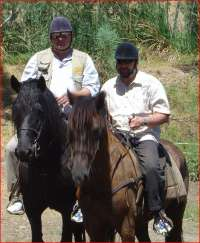 Riding horse with vine-journalist Radek John, Rhebokskloof vineyard, 2009