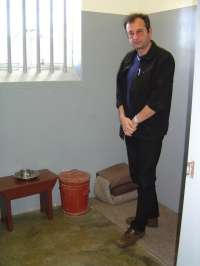 In the prison cell of Nelson Mandela at the Robben Island